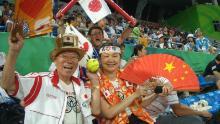 "Ishikawa (right) sits with Naotoshi Yamada, aka ""Uncle Olympics,"" at the Beijing Games in 2008."