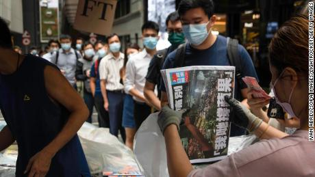People line up to buy the final edition of Apple Daily at a newsstand in the Central district of Hong Kong on Thursday.