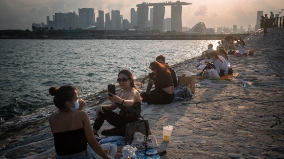 """Countries like Singapore are preparing to """"live with Covid."""""""
