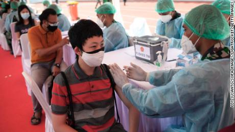 A health worker administers the Sinovac Covid-19 vaccine at the Gelora Bung Karno Stadium in Jakarta, Indonesia.