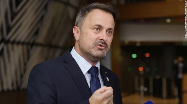 Luxembourg's Xavier Bettel talks to journalists on the second day of an EU summit on June 25.