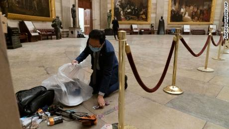 Rep. Andy Kim cleans up debris on the floor of the Rotunda of the US Capitol in the early morning hours of January 7.