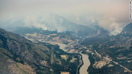 An aerial photo taken from a helicopter shows a wildfire burning in the mountains north of Lytton, British Columbia on July 1.