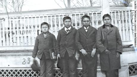 Four boys pose for a photograph on the grounds of the Carlisle Indian Industrial School, 1879.  The Elven Kills Seven Horse, second from left, was buried there and his remains are among those to be brought back to Rosebud.  Sioux reservations next week.