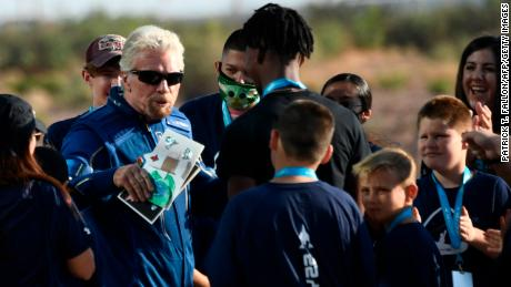 Richard Branson receives some cards from children as he walks out from Spaceport America, near Truth and Consequences, New Mexico on July 11, 2021.