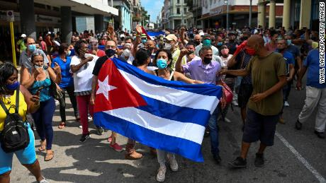 People take part in a demonstration to support the government of Cuban President Miguel Diaz-Canel in Havana, on July 11.