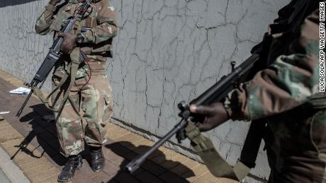 South Africa National Defence Force soldiers are deployed in Soweto to help police tackle deadly violence and looting.