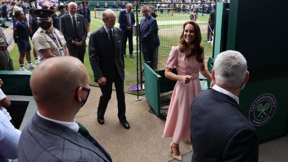 Kate leaves Centre Court at Wimbledon during finals weekend.