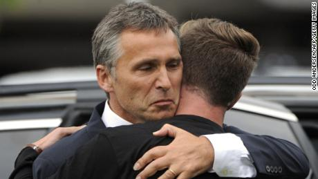 Norway's then-Prime Minister Jens Stoltenberg, left, embraces Eskil Pedersen, leader of the Norwegian Labour Youth league and a survivor of the Utoya attack, on July 23, 2011.