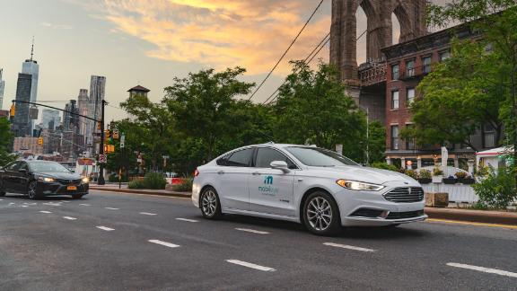 A self-driving vehicle from Mobileye's autonomous test fleet sits parked in front of the Manhattan Bridge in June 2021.