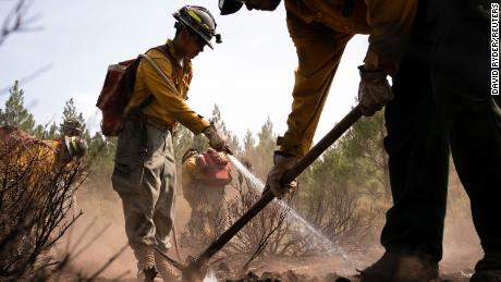 Firefighters extinguish hotspots in an area hit hard by the Bootleg Fire near Bly, Oregon, on July 19.