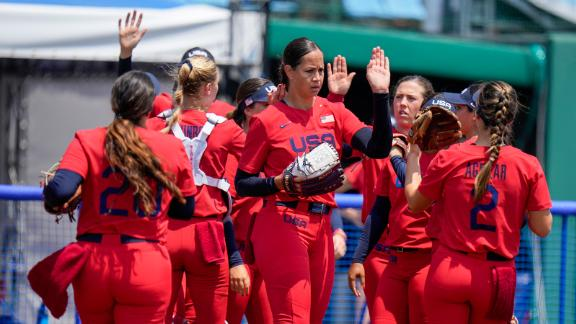 American Cat Osterman celebrates with teammates during the softball game between Italy and the US on Wednesday.