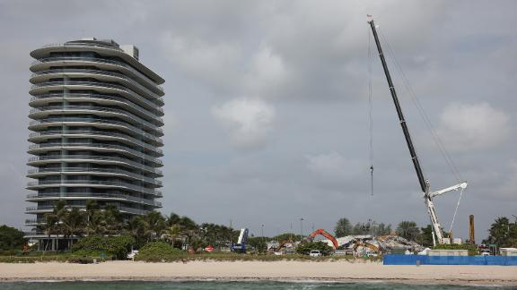 Cranes operate over the remains of the collapsed 12-story Champlain Towers South condo on July 09, 2021.