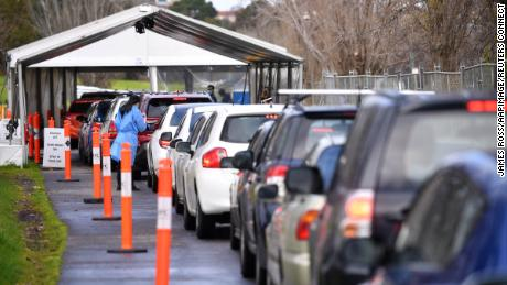 Cars wait in line at a drive-through Covid-19 testing facility in Melbourne, July 21, 2021.