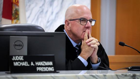 Miami-Dade Circuit Judge Michael Hanzman listens as tenants and condo owners share their thoughts on the site of the Champlain Towers South building that collapsed in Surfside, Florida.