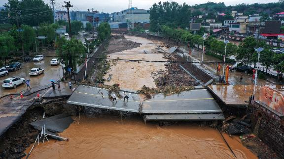 A damaged bridge following heavy rains which caused severe flooding in Gongyi in China's central Henan province on July 21, 2021