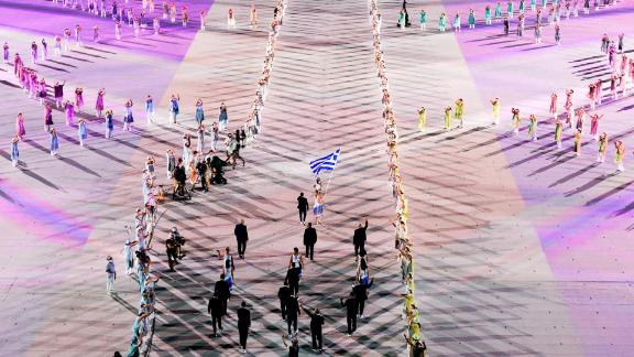 Greece's athletes march into the stadium to kick off the parade of nations.