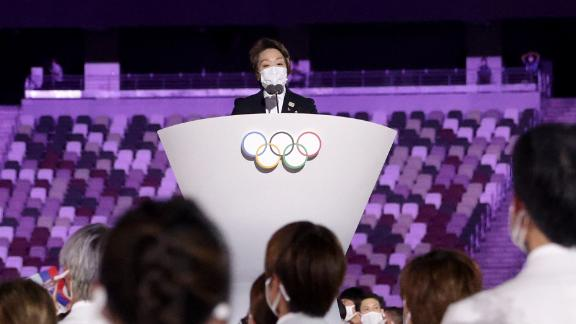 Seiko Hashimoto, president of the Tokyo 2020 organizing committee, makes a speech during the opening ceremony. At left is Thomas Bach, president of the International Olympic Committee.
