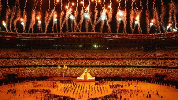 Fireworks go off after Osaka lit the Olympic cauldron.