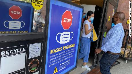 People shop at a grocery store enforcing the wearing of masks in Los Angeles on July 23, 2021.
