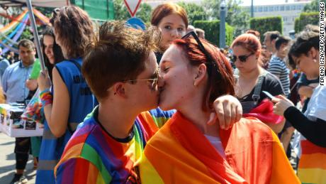LGBTQ activists kiss at a Pride event in Budapest on July 24.