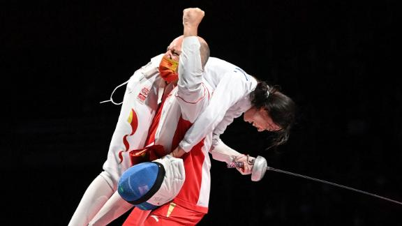 Chinese fencer Sun Yiwen celebrates with her coach Hugues Obry after winning gold in the épée on July 24.