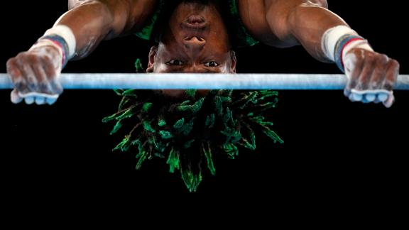 Nigerian gymnast Uche Eke competes on the horizontal bar on July 24.