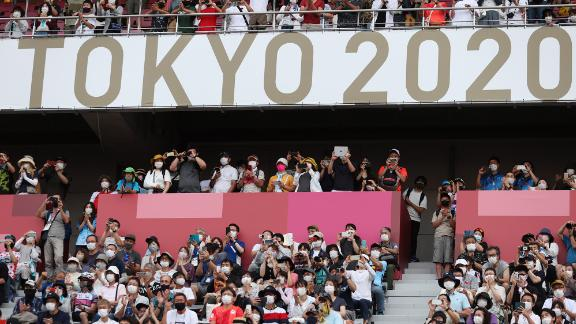 Fans wait at the finish of the men's cycling road race on July 24. The Fuji International Speedway, in Oyama, Japan, is one of the five Olympic venues open to fans this year.