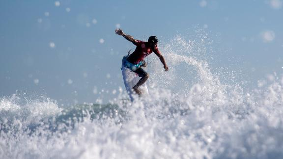 Brazilian surfer Italo Ferreira rides a wave during an early heat on July 25. This is the first year that surfing is in the Olympics.