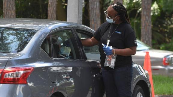 A person receives a nasal test at a Covid-19 testing and vaccination site at Barnett Park in Orlando, Florida, July 21, 2021.