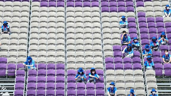 Volunteers sit in mostly empty stands during archery competition on July 26.