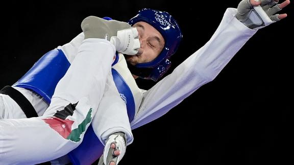 Norway's Richard Andre Ordemann is kicked in the face by Jordan's Saleh Elsharabaty during a taekwondo bout on July 26. Elsharabaty won 5-4.