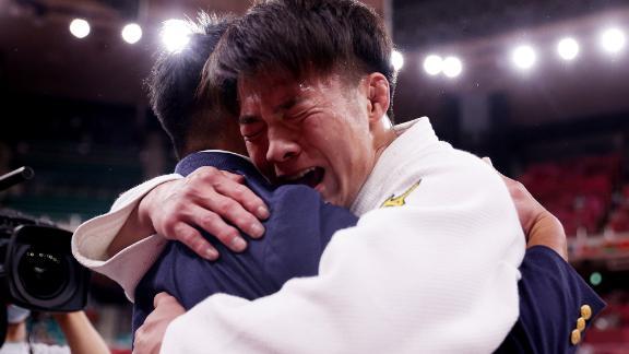Japan's Hifumi Abe celebrates after winning gold in judo on Sunday, July 25.