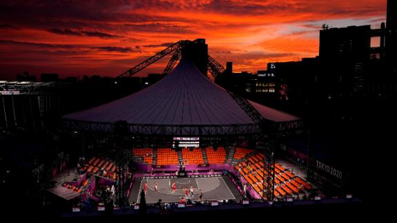 The sun sets in Tokyo on July 26 as Belgium plays the Netherlands in a men's 3-on-3 basketball game. The event is making its Olympic debut this year.