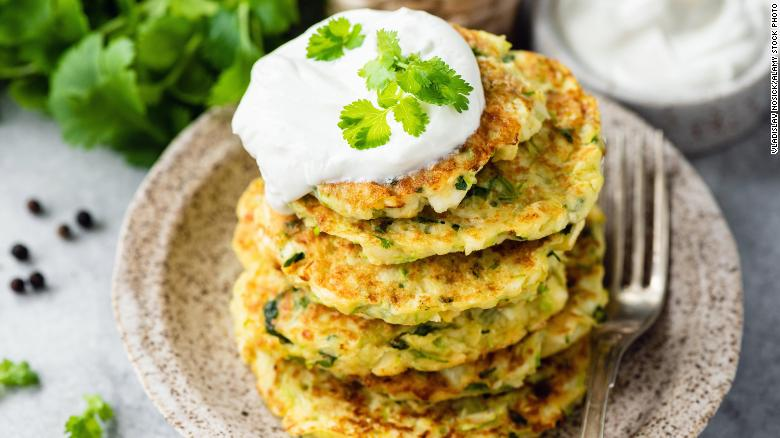 Zucchini fritters can be served with sour cream on top.