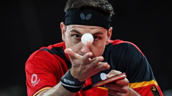 German table-tennis player Timo Boll serves during a match on July 27.
