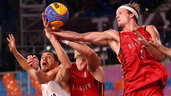 Serbia's Dusan Domovic Bulut, left, competes for the ball with Belgium's Rafael Bogaerts, center, and Thibaut Vervoort during a 3-on-3 basketball game on July 28. Serbia won the game for a bronze medal.
