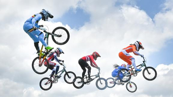 BMX racers compete in the women's quarterfinals on July 29.