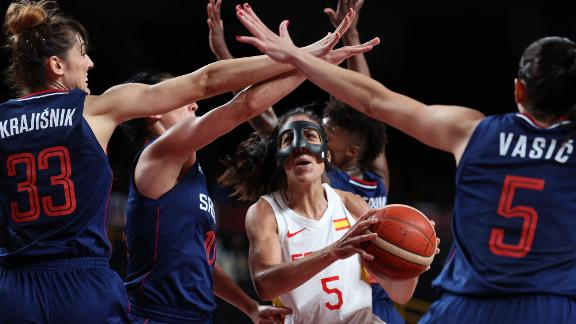 Spain's Cristina Ouviña, center, is defended by a group of Serbian players during a preliminary round basketball game on July 29.