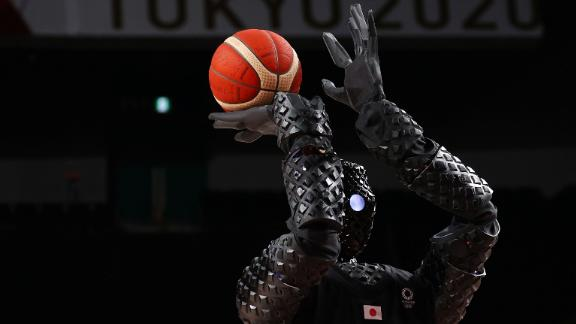 A robot shoots a free throw during halftime of a women's basketball game between Belgium and Puerto Rico on July 30.