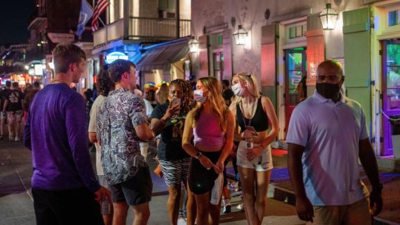 Emma Walton and Maddison Mansfield of Little Rock, Arkansas, walk down Bourbon Street in New Orleans.
