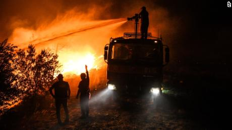 Firefighters try to get the fire under control in Kirli village near the town of Manavgat, in Antalya province, early Friday July 30.