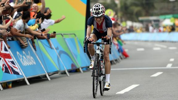 Abbott crosses the finish line of the road race at the 2016 Rio Olympics.