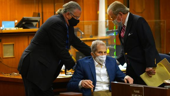 Defense attorneys Dick DeGuerin, right, and David Z. Chesnoff adjust Robert Durst's wheelchair as attorneys begin opening statements in his murder trial at Inglewood Courthouse on May 18, 2021.