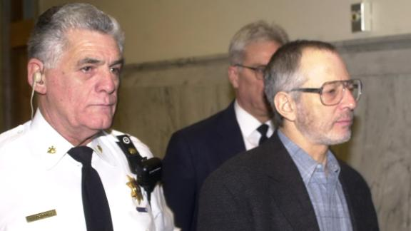 Durst is escorted from Northampton County Courthouse in Easton, Pennsylvania, in 2002.