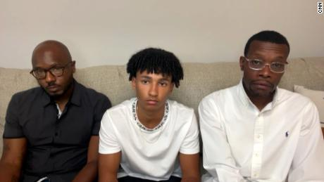 Roy Thorne, left, is seen with his 15-year-old son Samuel, middle, and realtor Eric Brown.  All three were handcuffed while visiting a home by Wyoming, Michigan, police officers.