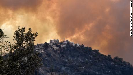 Smoke rises from a wildfire in the forested hills of the Kabylie region on August 10.