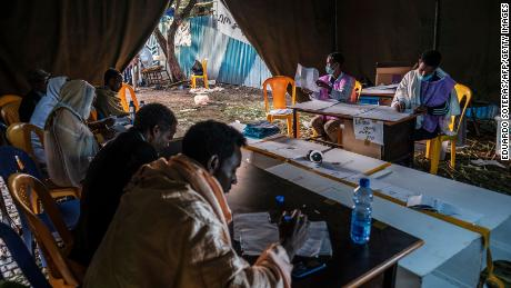 Electoral officials count ballots at a polling station in the city of Bahir Dar, Ethiopia, in June.