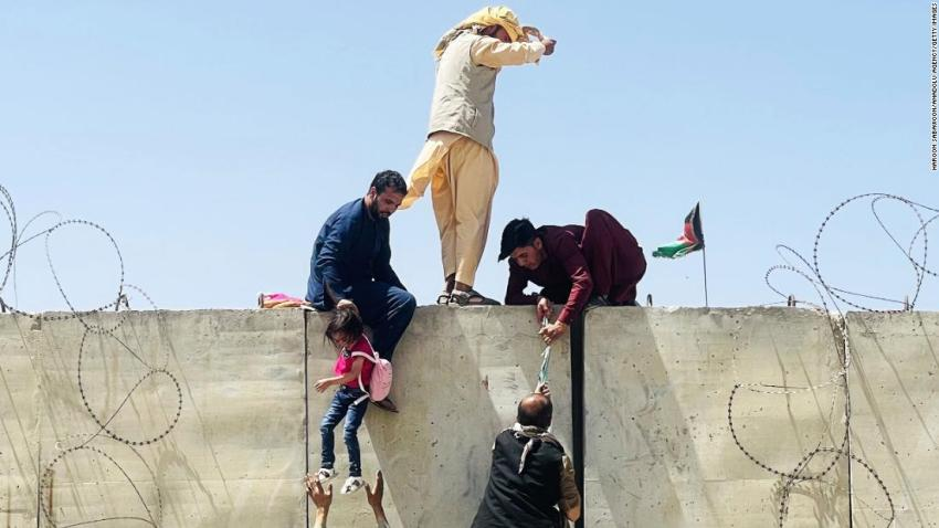 Afghans rush to the airport in Kabul as they try to flee the capital on August 16.