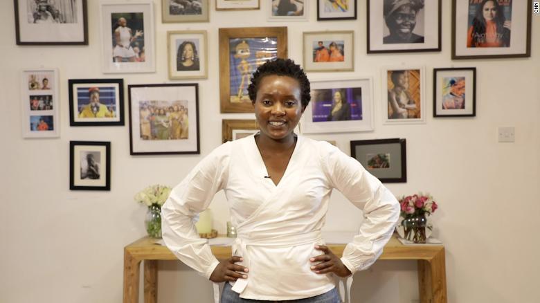 Njeru, head of production at Kukua, in front of Kukua's wall of inspirational women.